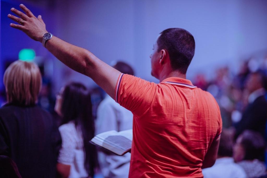 man raising his left hand 2351722 - Philippine Bible Society