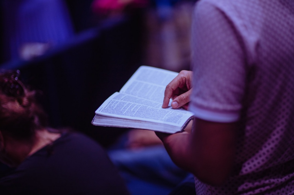 selective focus photo of person holding book 2351719 - Philippine Bible Society